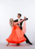 Ballroom Dancers with Orange Gown Stock Images