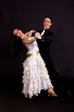 Ballroom Dancers White 01. Young ballroom dancers in formal costumes posing against a solid background in a studio Royalty Free Stock Image
