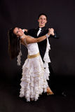 Ballroom Dancers White 02. Young ballroom dancers in formal costumes posing against a solid background in a studio Stock Images