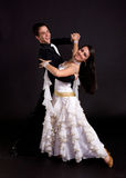 Ballroom Dancers White 03. Young ballroom dancers in formal costumes posing against a solid background in a studio Stock Image