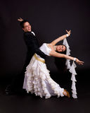 Ballroom Dancers White 04. Young ballroom dancers in formal costumes posing against a solid background in a studio Stock Photography