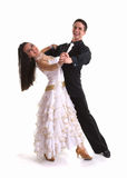 Ballroom Dancers White 07. Young ballroom dancers in formal costumes posing against a solid background in a studio Royalty Free Stock Photo