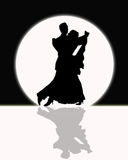 Ballroom Dancing In The Moonlight, Black and White. Silhouette of couple ballroom dancing in full moonlight during black and white event Stock Photo