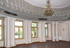 Ballroom detail. Palace ballroom hall with decorative ceiling elements and chandelier in Pakruojis, Lithuania, classicism style Royalty Free Stock Photography