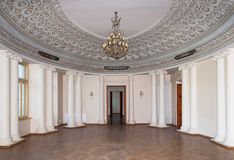 Ballroom. Palace ballroom hall with decorative ceiling elements and chandelier in Pakruojis, Lithuania, classicism style Stock Photography