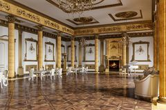 The ballroom and restaurant in classic style. 3D render. The ballroom and restaurant in classic style. Interior in yellow and beige colors. 3D render Stock Photo