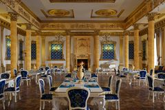 The ballroom and restaurant in classic style. 3D render. The ballroom and restaurant in classic style. Interior in yellow and blue colors. 3D render royalty free stock image