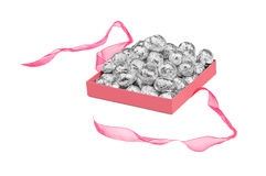 Balls in aluminum foil in an open box Royalty Free Stock Photos