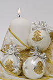 Balls around the candle. Still life about Christmas with a candle and some Christmas balls around it Stock Photography