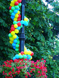 Balls are attached to a lantern in park. Beautiful by air multi-coloured balls are attached to a lantern in park Stock Photos