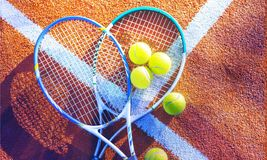 Tennis game. Tennis balls and rackets on stock photography