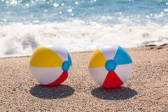 Balls on the beach. With blue sea background stock photos
