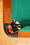 Balls in Billiards table pocket stock images