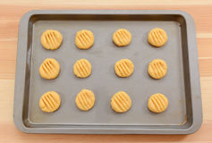 Balls of biscuit dough marked with a fork Royalty Free Stock Photo