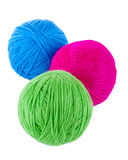 Balls of blue, red and green wool. Isolated on a white background Stock Photos
