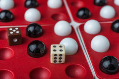 Balls and bones on the wells, game's simbol Royalty Free Stock Photography