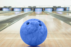 Balls on bowling alley against ten pins.  royalty free stock images