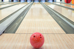 Balls on bowling alley against ten pins.  royalty free stock photo