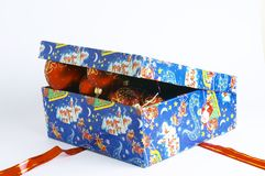 Balls in box. Open gift box with red balls inside isolated Stock Photography