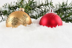 Balls and a branch in snow Stock Images