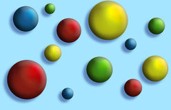 Balls Buttons. Assortment of and balls/buttons  layered on a light blue background Royalty Free Stock Images