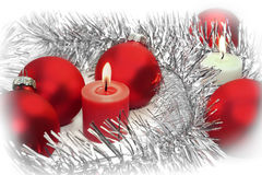 Balls and candles. Red christmas ornaments and two candles on white background stock photo