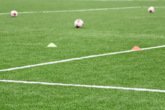 Balls and chips for football training. Sports background. Stock Photography