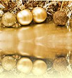 Balls Christmas background. Gold Christmas background with balls and tinsel Stock Photography