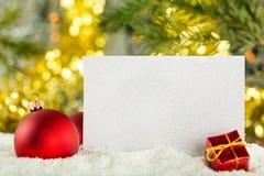 Blank postcard, Christmas balls and fir-tree on stock photography