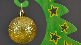 New Year`s yellow toy on an artificial Christmas tree is spinning. Balls on the Christmas tree. Christmas background stock footage