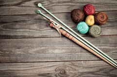 Balls of colored iris yarn and wooden spindle on  horizontal boa Stock Photos
