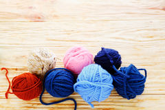 Balls of colored yarn on the boards Royalty Free Stock Photo