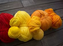 Balls of colored yarn.The process of knitting caps. stock images
