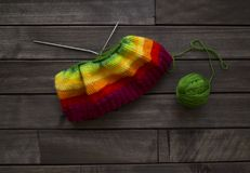 Balls of colored yarn.The process of knitting caps. The view from the top. All colors of the rainbow. Sample Jersey. Crochet Stock Photos