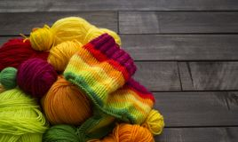 Balls of colored yarn.The process of knitting caps. The view from the top. All colors of the rainbow. Sample Jersey. Crochet Stock Images