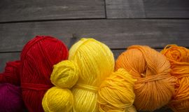 Balls of colored yarn.The process of knitting caps. The view from the top. All colors of the rainbow. Sample Jersey. Crochet Royalty Free Stock Photo
