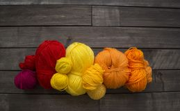 Balls of colored yarn.The process of knitting caps. The view from the top. All colors of the rainbow. Sample Jersey. Crochet Royalty Free Stock Images