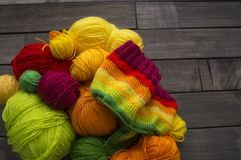 Balls of colored yarn.The process of knitting caps. The view from the top. All colors of the rainbow. Sample Jersey. Crochet Stock Photography