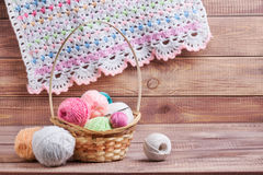 Balls of colored yarn. On wooden boards Royalty Free Stock Photos