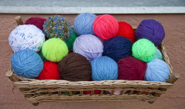 Balls of Coloured Wool. In outdoor market stock image