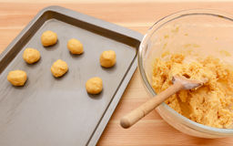 Balls of cookie dough on a baking sheet Stock Photography