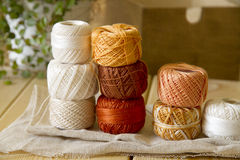 Balls of cotton threads in orange and beige Royalty Free Stock Photos