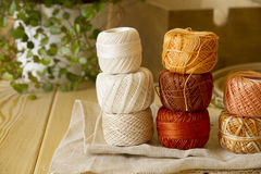 Balls of cotton threads in orange and beige Stock Image