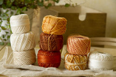 Balls of cotton threads in orange and beige Stock Images