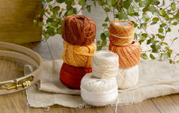 Balls of cotton threads in orange and beige color Stock Photography