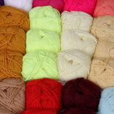 Balls of cotton and wool for sale at the market. Of tailors Royalty Free Stock Photos