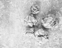 Balls of crumpled old paper on a concrete table. The concept of inappropriate, spent ideas.  stock photography