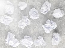 Balls of crumpled paper on a gray concrete surface. Balls of crumpled paper on a gray concrete surface royalty free stock images