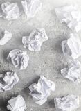 Balls of crumpled paper on a gray concrete surface. Balls of crumpled paper on a gray concrete surface royalty free stock photography