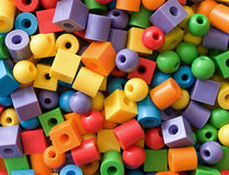 Balls, cylinders and cubes. Small colored balls, cylinders and cubes Royalty Free Stock Photography
